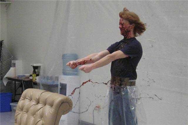 Steve Tolin demos the blood chair at Berkeley Rep